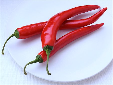 spicy - Red chillies on a white background Stock Photo - Rights-Managed, Code: 824-07193765