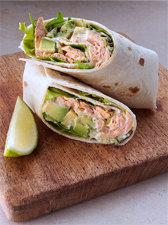 Salmon avocado wraps on a wooden board Stock Photo - Rights-Managed, Code: 824-07193859