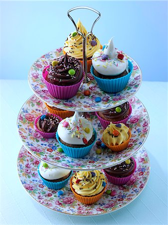 self indulgence - Cupcakes and fairy cakes on a cakestand Stock Photo - Rights-Managed, Code: 824-07193956