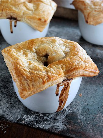 puff - Beef and Guiness pies on a baking sheet Stock Photo - Rights-Managed, Code: 824-07193979