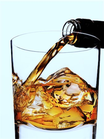 pouring - Whisky being poured in to glass with ice Stock Photo - Rights-Managed, Code: 824-07562800