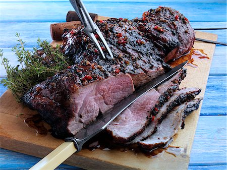 Butterflied leg of lamb marinaded and barbecued Stock Photo - Rights-Managed, Code: 824-07585818