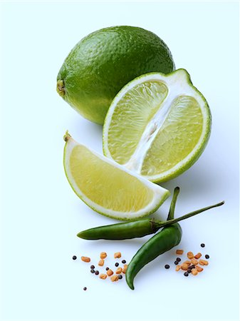 Limes and chillies on a white background Stock Photo - Rights-Managed, Code: 824-07585851