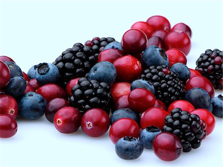 Cranberries blackberries and blueberries on a white background Stock Photo - Rights-Managed, Code: 824-07585861