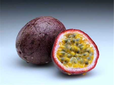 passion - Whole passion fruit and half cut with seeds Stock Photo - Rights-Managed, Code: 824-07586125