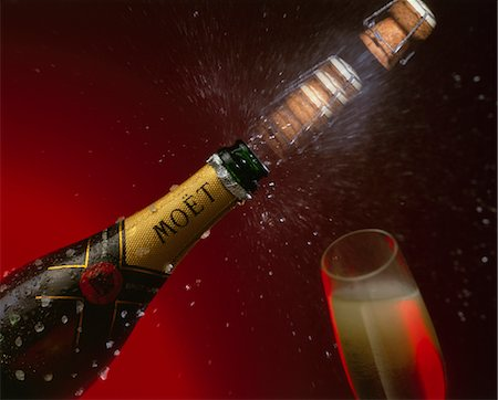 Cork popping from Champagne bottle Stock Photo - Rights-Managed, Code: 824-02889659