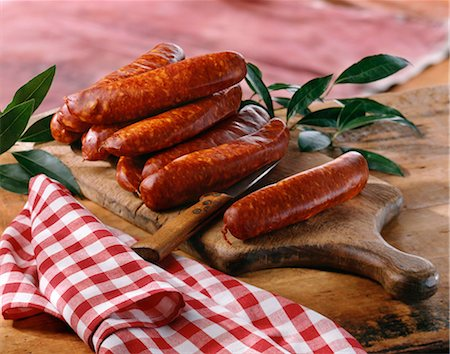 smoked - Sausages on a chopping board Stock Photo - Rights-Managed, Code: 825-05815677
