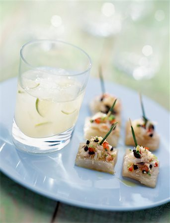 Margarita cocktail with fish canapés Stock Photo - Rights-Managed, Code: 825-05811966