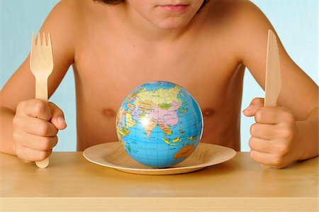 Child in front of a plate with a globe Stock Photo - Rights-Managed, Code: 825-05836554