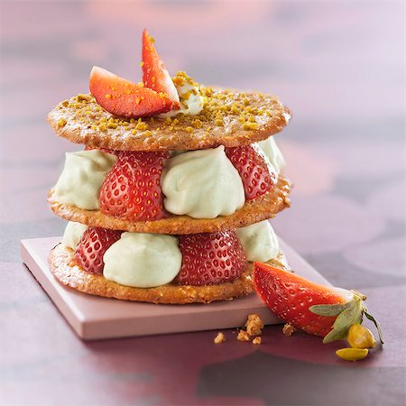Crunchy pastry,strawberry and pistachio whipped cream dessert Stock Photo - Rights-Managed, Code: 825-06815345