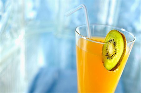 Glass of orange juice with a slice of kiwi Stock Photo - Rights-Managed, Code: 825-06815625