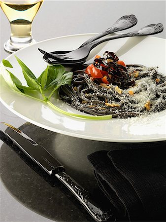 Squid ink spaghetti with purple peppers Stock Photo - Rights-Managed, Code: 825-06816406
