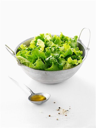 Lettuce salad with a spoonful of olive oil Stock Photo - Rights-Managed, Code: 825-06818226