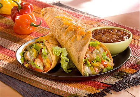 Chicken,rice and vegetable burritos with spicy tomato salsa Stock Photo - Rights-Managed, Code: 825-07077508