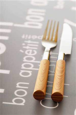 "Knife and fork on a table with the inscription ""Bon appetit"" Stock Photo - Rights-Managed, Code: 825-07077983"