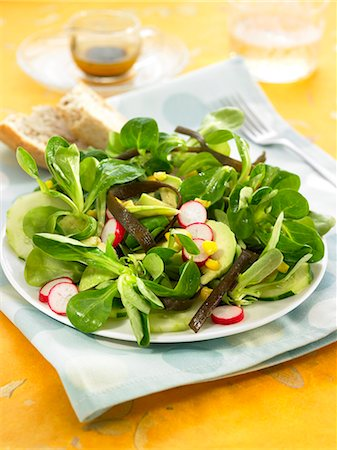 Corn lettuce,sea thong,avocado,radish and cucumber salad Stock Photo - Rights-Managed, Code: 825-07522167