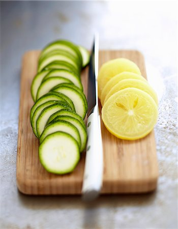 Slicing zucchinis and confit citrus Stock Photo - Rights-Managed, Code: 825-07649238
