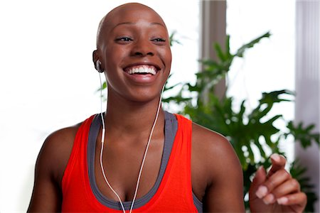 Smiling Woman Wearing Earphones Stock Photo - Rights-Managed, Code: 822-05554351