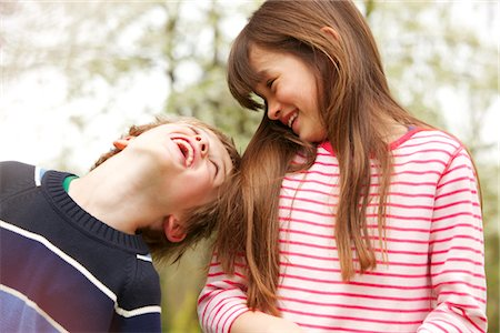 Boy and Girl Laughing and Looking at Each Other Stock Photo - Rights-Managed, Code: 822-05554383