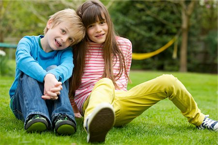 Boy and Girl Sitting on Lawn Stock Photo - Rights-Managed, Code: 822-05554439