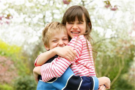 Smiling Boy and Girl Hugging Outdoors Stock Photo - Rights-Managed, Code: 822-05554470