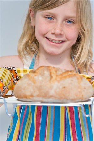 Young Girl Holding Rack with Loaf of Bread Stock Photo - Rights-Managed, Code: 822-05554487