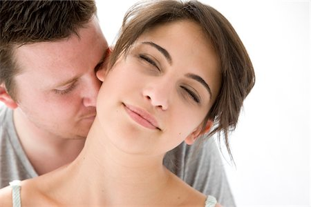 Man Kissing Back of Woman Neck Stock Photo - Rights-Managed, Code: 822-05554508
