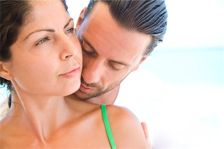 Man Kissing Woman Shoulder from Behind Stock Photo - Rights-Managed, Code: 822-05554523