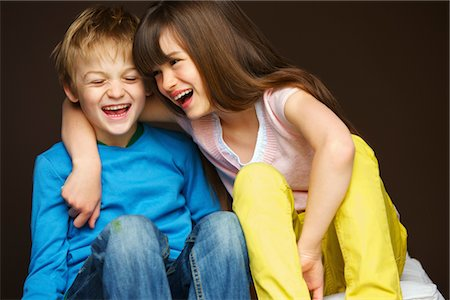 Boy and Girl Hugging and Laughing Stock Photo - Rights-Managed, Code: 822-05554539