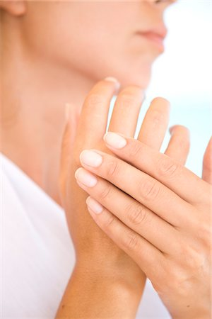 personal care - Woman Massaging Hands, Close-up view Stock Photo - Rights-Managed, Code: 822-05554543
