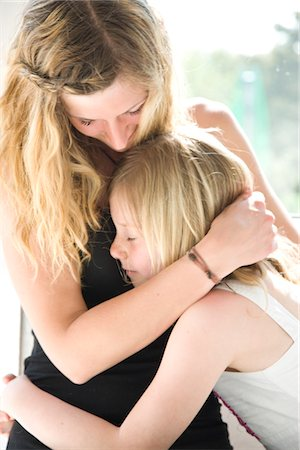 preteen touch - Mother and Daughter Hugging Stock Photo - Rights-Managed, Code: 822-05554555