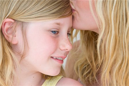 preteen touch - Woman Kissing Girl on Forehead Stock Photo - Rights-Managed, Code: 822-05554559