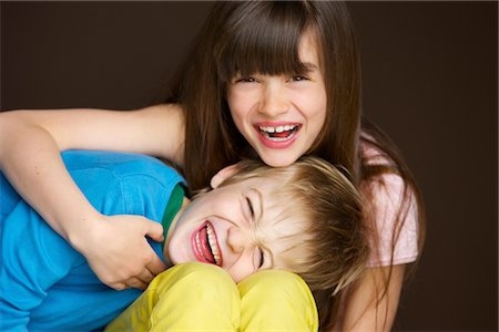 Boy and Girl Hugging and Laughing Stock Photo - Rights-Managed, Code: 822-05554561