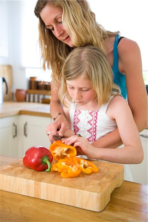 daughter middle-aged mother women young adults - Mother and Daughter Slicing Bell Peppers Stock Photo - Rights-Managed, Code: 822-05554578