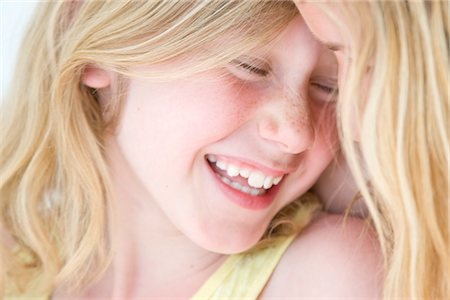 Mother and Daughter Cuddling Stock Photo - Rights-Managed, Code: 822-05554580