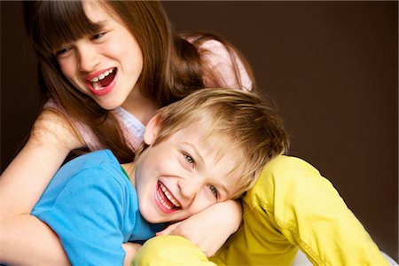 Boy and Girl Hugging and Laughing Stock Photo - Rights-Managed, Code: 822-05554583