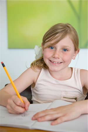 Smiling Girl Doing Homework Stock Photo - Rights-Managed, Code: 822-05554633