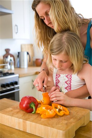 daughter middle-aged mother women young adults - Mother and Daughter Slicing Bell Peppers Stock Photo - Rights-Managed, Code: 822-05554647