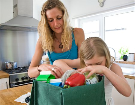 daughter middle-aged mother women young adults - Mother and Daughter Unpacking Groceries Stock Photo - Rights-Managed, Code: 822-05554649