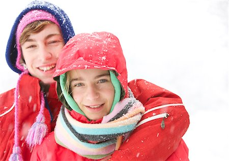 Boy and Girl Hugging under Snow Stock Photo - Rights-Managed, Code: 822-05554664