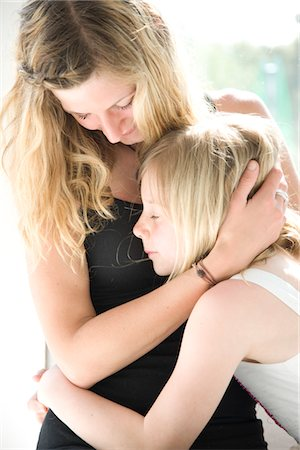 preteen touch - Mother and Daughter Hugging Stock Photo - Rights-Managed, Code: 822-05554661
