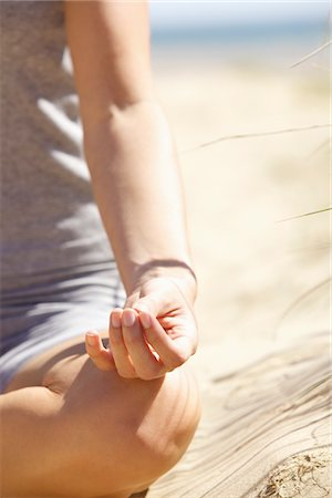 Woman's Hand Resting on Knee in Mudra Position Stock Photo - Rights-Managed, Code: 822-05554675