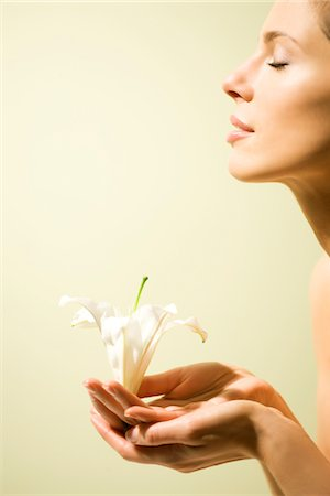 Profile of a Woman Holding White Lily in her Hands Stock Photo - Rights-Managed, Code: 822-05554698