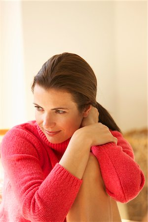 Woman Hugging One Knee and Touching her Neck Stock Photo - Rights-Managed, Code: 822-05554719