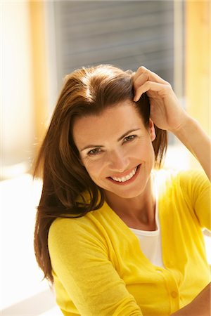 Smiling Woman Touching her Hair Stock Photo - Rights-Managed, Code: 822-05554746