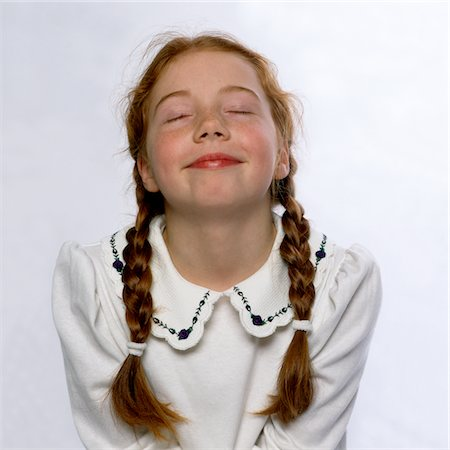 preteen girl pigtails - Smiling Girl with Eyes Closed and Head Tilted Back Stock Photo - Rights-Managed, Code: 822-05554800
