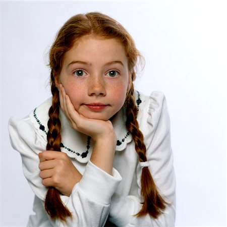 red hair preteen girl - Girl Resting Chin on Hand Stock Photo - Rights-Managed, Code: 822-05554801