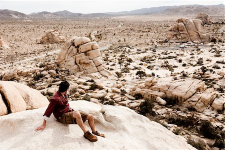 Man Sitting on Boulder Admiring View Stock Photo - Rights-Managed, Code: 822-05554803