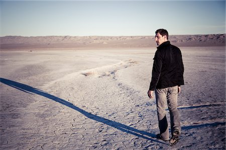 Man Walking in Desert Landscape Stock Photo - Rights-Managed, Code: 822-05554818