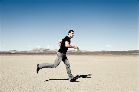 Man Running in Desert Landscape Stock Photo - Rights-Managed, Code: 822-05554819